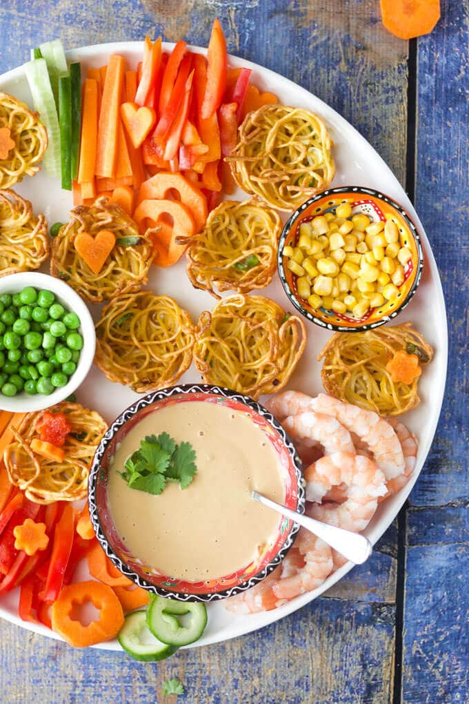 Noodle baskets with a peanut sauce. A fun and interactive way to get kids to eat veggies. Fill the noodle baskets with a range of veggies and drizzle with the peanut sauce. Kids food, great for fussy eaters.